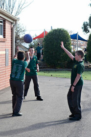 students playing ball